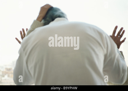 Mature couple embracing passionately, rear view - Stock Photo