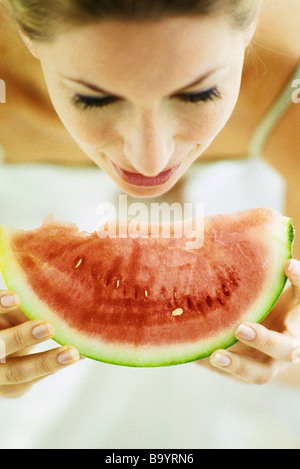 Woman eating slice of watermelon - Stock Photo