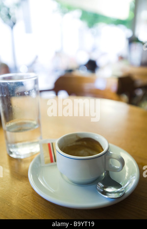 Dirty coffee cup left on cafe table - Stock Photo