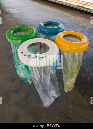 Colour coded recycling bags Bologna Station Italy White for paper yellow for plastic blue for aluminium green for - Stock Photo