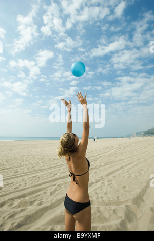 Teen girl playing beach volleyball - Stock Photo
