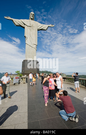 RIO DE JANEIRO BRAZIL. TOURISTS TAKE PICTURES ON CORCOVADO HILL BELOW CHRIST THE REDEEMER STATUE - Stock Photo
