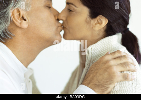 Mature couple kissing, close-up - Stock Photo