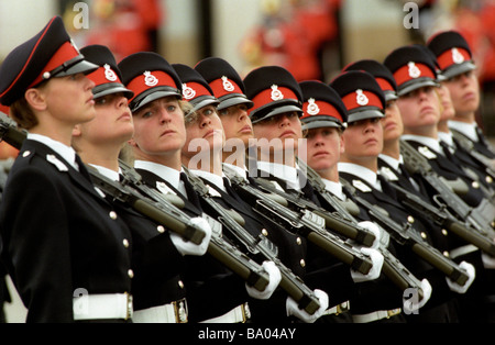 Female Officer cadets in passing out parade at Sandhurst Military academy UK - Stock Photo