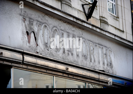The remains of a Woolworths sign on a store front - Stock Photo