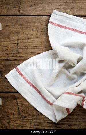 Tea Towel on Wooden Table - Stock Photo