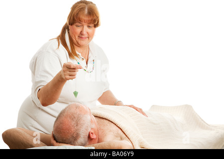 New age healer using a jade pendulum to unblock her patient s energy centers  - Stock Photo