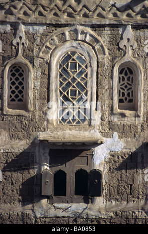 Decorated Windows & Shutters of an Adobe Mud Brick Tower House, Sana'a or San'a, Republic of Yemen - Stock Photo