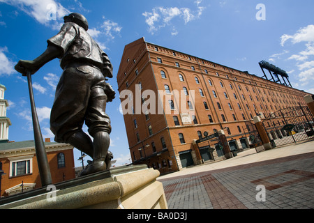 Babe Ruth statue fronts Orioles Park at Camden yards B and O warehouse longest building on East Coast Baltimore - Stock Photo