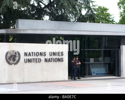 Two officers stand guard at the entrance to the United Nations in Geneva Switzerland - Stock Photo