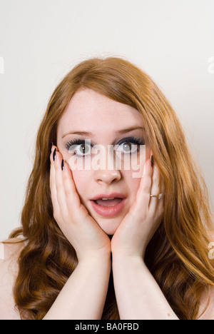 Young woman in shock - Stock Photo