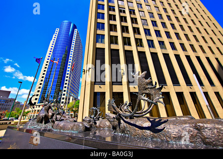 Bronze sculpture of caribous crossing a river,titled 'Seal River Crossing' outside the Richardson Building.