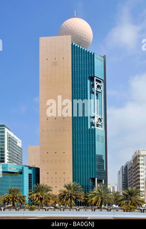 Abu Dhabi modern architecture high rise block with sphere on roof - Stock Photo
