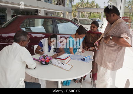 the new Tata car the Nano has been release in the shop of india and indian people seems to be really interresting - Stock Photo