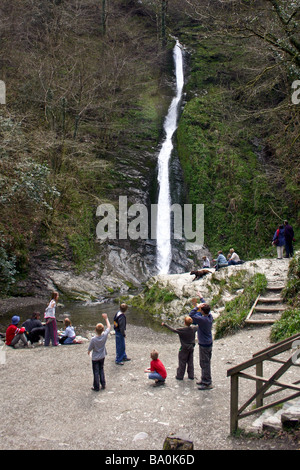 People enjoying themselves at a Dartmoor waterfall - Stock Photo