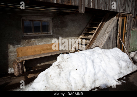 Entrance to an old wooden village house in Hinterrhein, Switzerland - Stock Photo