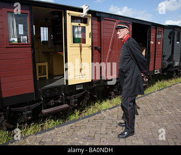 Conductor at station for recreation steam train Medemblik Netherlands - Stock Photo