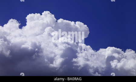 Fuffy white clouds with blue sky - Stock Photo