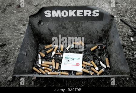 Cigarette bin - Stock Photo