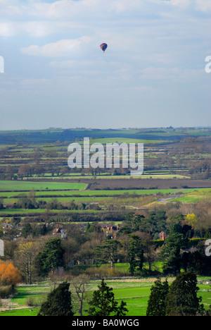 Hot air balloon over Chiltern Hills near Aston Clinton, bucks, England, UK - Stock Photo