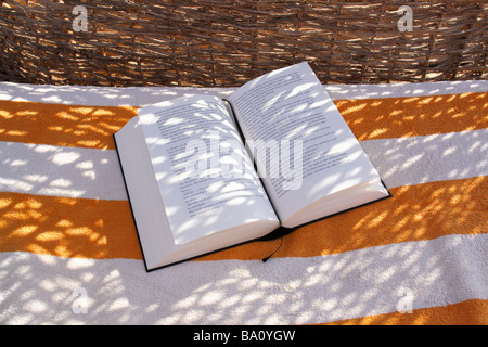 book on towel - Stock Photo