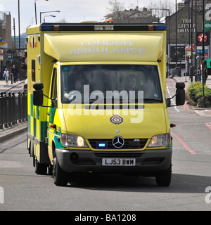 London Ambulance travelling at speed on emergency call out - Stock Photo