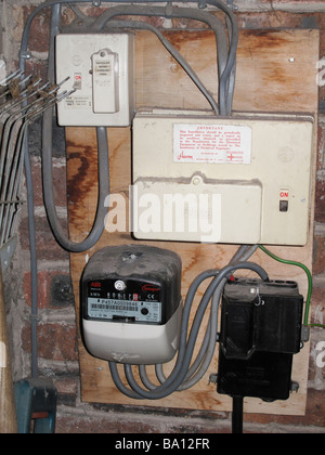 Domestic electricity meter and distribution board - Stock Photo