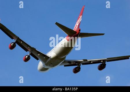 A Virgin Atlantic Boeing 747 400 Jet Airplane takes off - Stock Photo