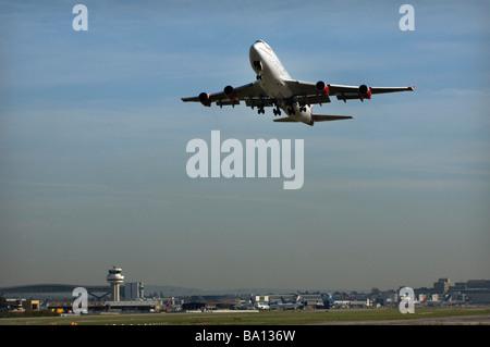 A Virgin Atlantic Boeing 747 Jumbo Jet takes off from Gatwick Airport West Sussex on a transatlantic flight - Stock Photo
