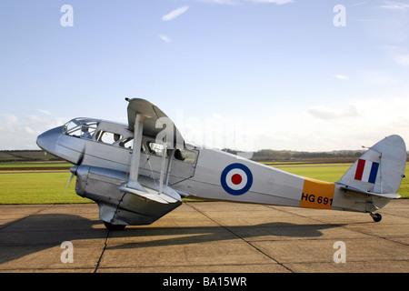 A De Havilland DH89A Rapide Dominie G-AIYR painted as HG691 in silver RAF training scheme - Stock Photo