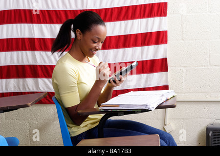 Student using a calculator in class - Stock Photo
