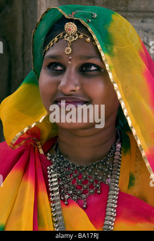 Young Indian woman in traditional dress in Udaipur, Rajasthan State, India - Stock Photo