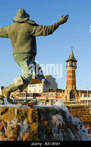 Skegness the Jolly Fisherman and Clock Tower . - Stock Photo
