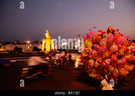 woman selling toy balloons in Saigon Ho Chi Minh City Vietnam - Stock Photo