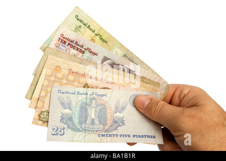 Money male hands holding handful of Egyptian currency - Stock Photo