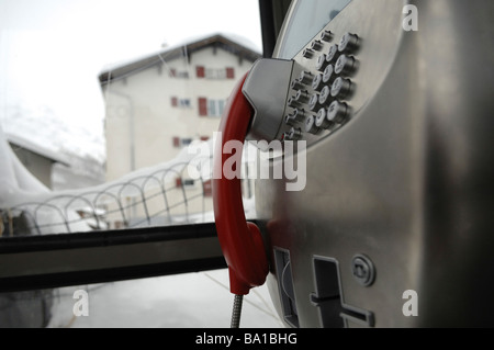 Close up of a Swiss telephone box in the Alpine village of Saas Fee in winter - Stock Photo