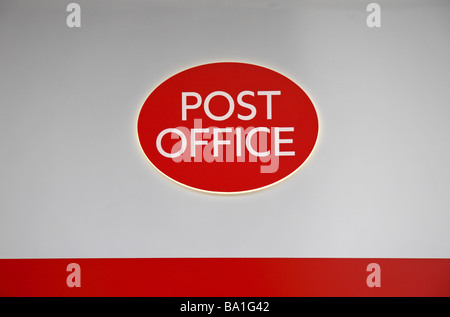 The Post Office logo on a sign above the entrance to the Post Office on the Edgware Road, London. - Stock Photo