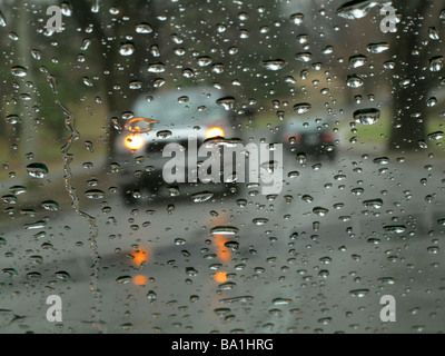 Looking through wet windshield of car. - Stock Photo