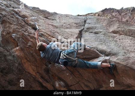 Man climbs in a shallow cave, Eldorado Canyon State Park, Eldorado Springs, Colorado. - Stock Photo
