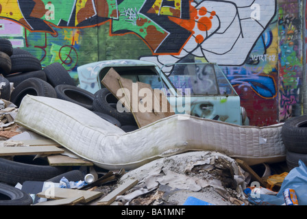 General rubbish and an abandoned AC Invacar in Hackney Wick, London - Stock Photo