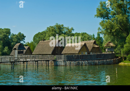 Replica of stone age settlement Unteruhldingen Lake Constance Baden Wuerttemberg Germany | Steinzeit Pfahlbauten, - Stock Photo