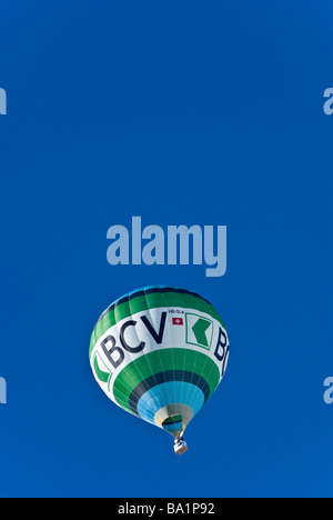 Banque Cantonal Vaud title sponsor balloon at the 2009 International Hot Air Balloon festival Chateau d'Oex Switzerland. - Stock Photo