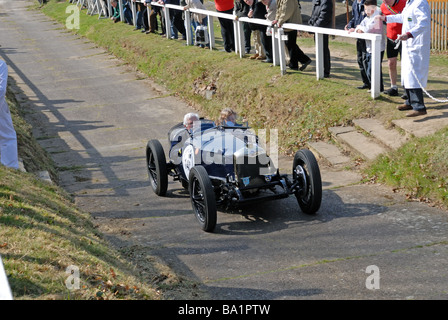 VM 4913 a 1928 Riley Brooklands Julian Booty ascending at speed on the Brooklands Museum Test Hill Challenge celebrating - Stock Photo
