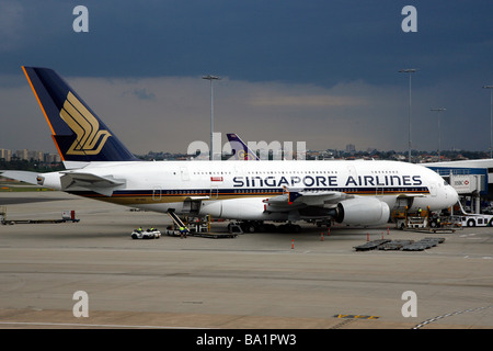 A Singapore Airlines Airbus A380 Superjumbo aircraft sits on the tarmac at Sydney Kingsford Smith International - Stock Photo