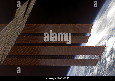 March 22, 2009 - International Space Station's solar array panels and Earth's horizon. - Stock Photo