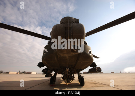 An AH-64 Helicopter sits on the flight line at Camp Speicher. - Stock Photo