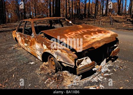 Bush Fires Australia / A burnt out motor vehicle in bushland.Kinglake Victoria Australia. - Stock Photo