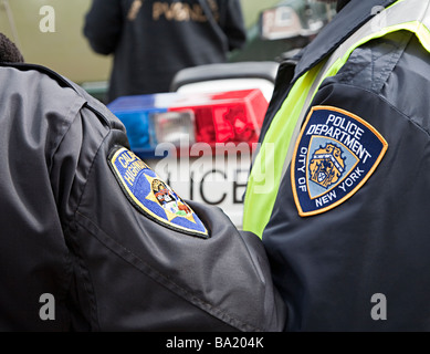Two men wearing police badges on arm for California Highway and New York Police Department at rally recreation - Stock Photo