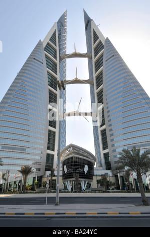 Bahrain Manama World Trade Center twin towers with wind turbines - Stock Photo