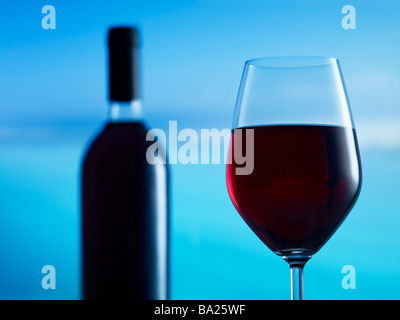 Glass of red wine with bottle in background 39MP capture - Stock Photo